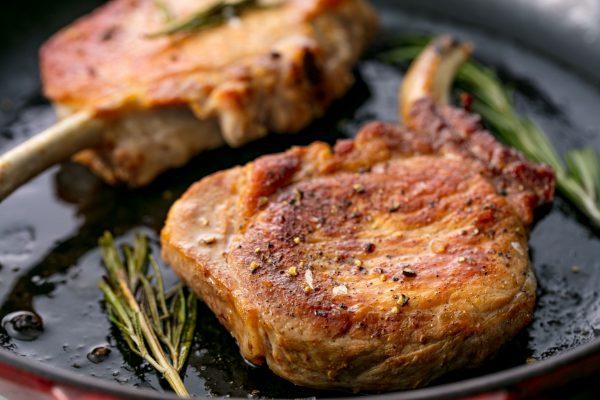 1503418779-pork-chops-delish